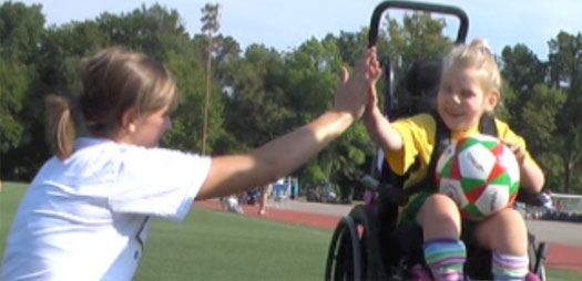 Katy high fives Whitney during wheelchair soccer practice